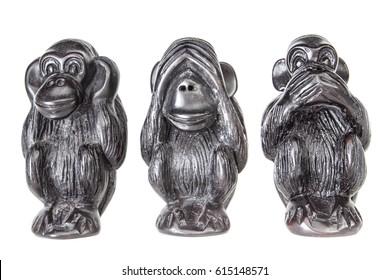 three black monkeys statue on white background