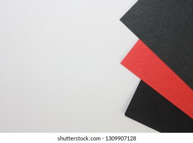 Three black red papers triangle decor on white background