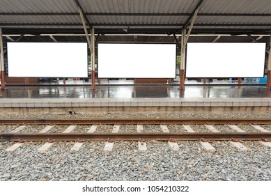 Three Blank Billboards on Railway Station Platform with Railroad Foreground.