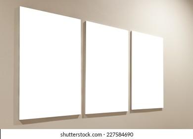three blank frame on wall