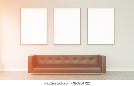 Three blank frames hanging over a brown leather sofa. Concrete background. Front view, filter. Concept od exhibition.