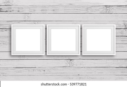 Three blank frames on old white painted panels wall, retro style, rustic home decor mock up