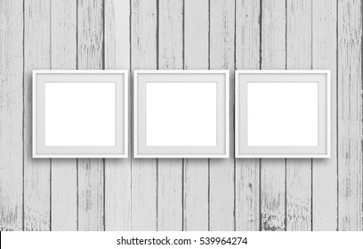 Three blank frames on old white painted vertical panels wall. Rustic home, retro style  decoration mock up