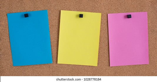 Three Blank Notes on a Bulletin Board