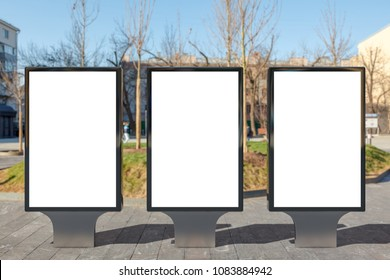 Three blank street billboard poster stands on city background. 3d illustration.