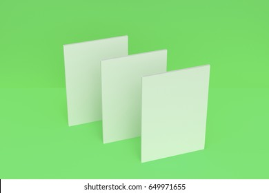 Three blank white closed brochure mock-up on green background. Magazine cover template. 3D rendering illustration