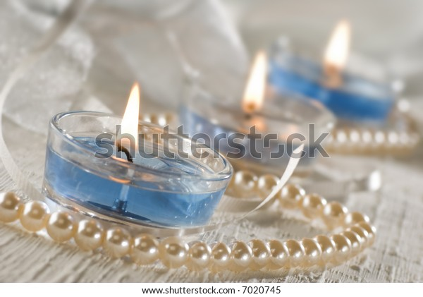 three blue candles decorated close up shoot