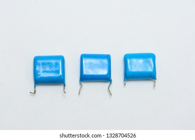 Three blue film capacitors. Different siize capacitors. On white background