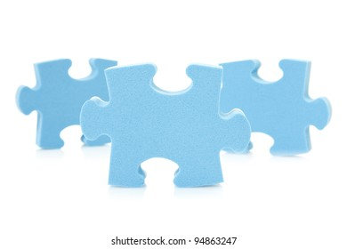 three blue  puzzle pieces over a white background