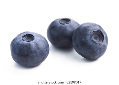 Three blueberries isolated on white background.