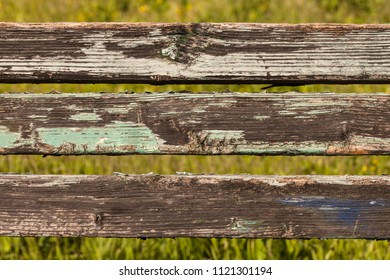 Three boards with old texture on the background of green grass