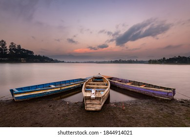 Three boats and dusk sky at Situ Cileunca. Situ Cileunca is a lake in Pangalengan, West Java, Indonesia