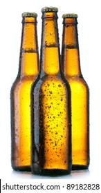 three Bottle with beer and drops on white background