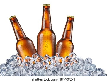 Three bottles of beer in the ice cubes isolated on a white background. File contains clipping paths.
