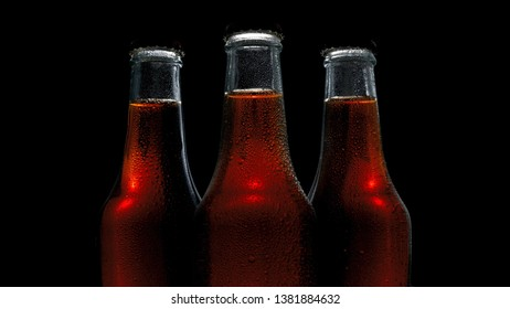 three bottles of chilled drink