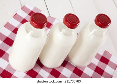 three bottles of milk