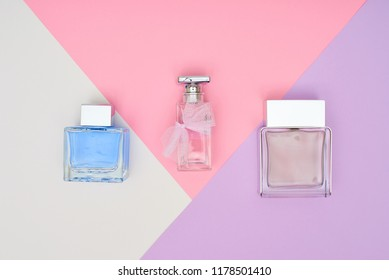 Three bottles  on the pink table