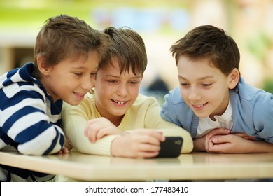 Three boys surfing the net on smartphone