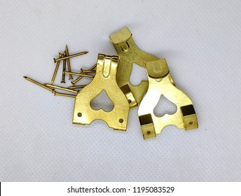 Three Brass Picture Hooks With Tacks - Image