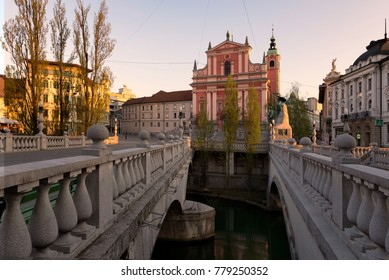 Three bridges leading to the Presern square with Franciscan Church of the Annunciation in the center of Ljubljana, Slovenia.
