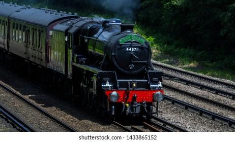Three Bridges Sussex UK June 2019 : LMS Stanier Class 5 4-6-0 No. 44871 is a preserved British steam locomotive seen here on a steam special