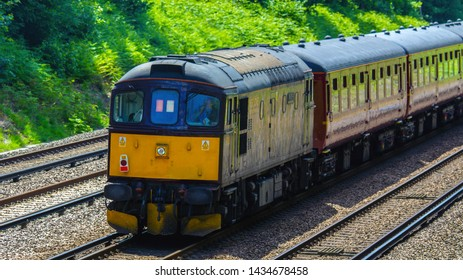 Three Bridges Sussex UK June 2019 A class 33 diesel loco on the back of a steam special going to Eastbourne