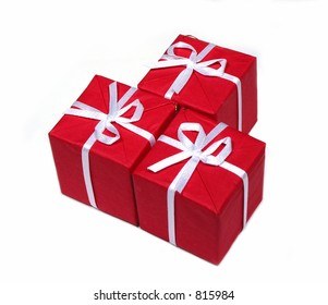 Three bright red gift boxes isolated on white background