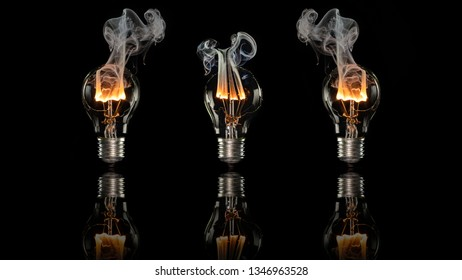 three broken light bulbs where the wire burns through in front of a black background