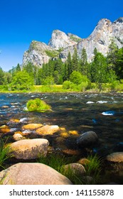 Three Brothers Rock with Merced River in Yosemite National Park, California