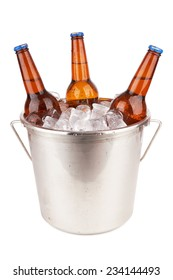 Three brown beer bottles in a bucket of ice isolated on a white background.