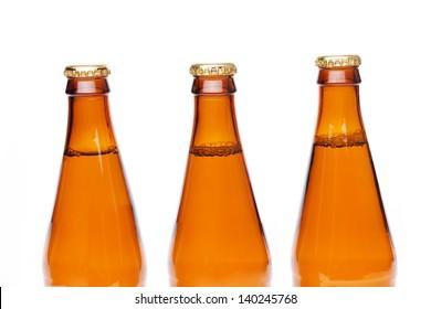 Three brown neck bottles