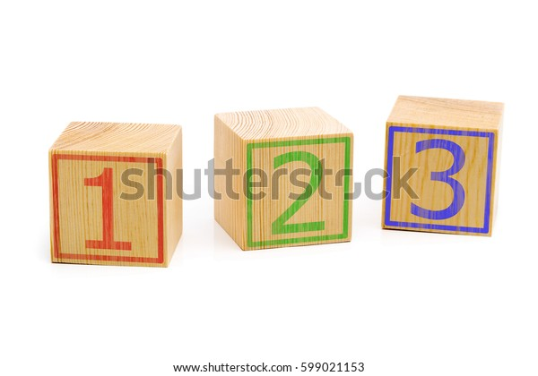Three brown wooden cubes lined up in a row with numbers one, two and three over white background - education or counting concept