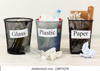 Three buckets of assorted debris on room background