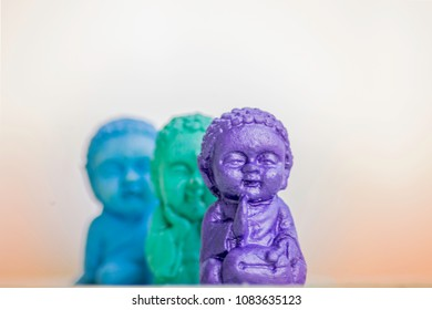 Three Buddhas in different positions where one is main in the shot and the rest are out of focus