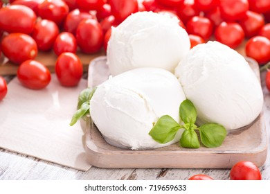 three buffalo mozzarella cheese with raw tomatoes