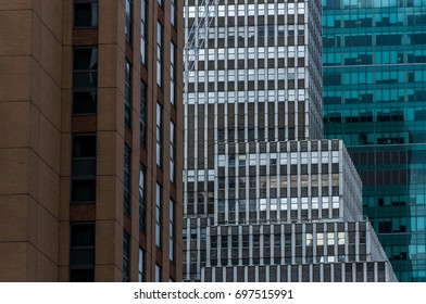 Three buildings in New York City in green white and brown