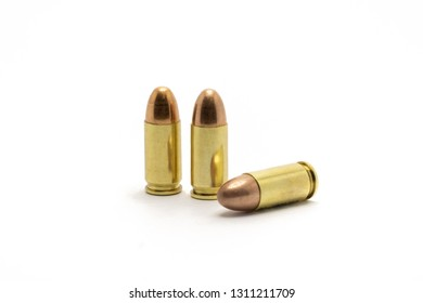 Three bullets, 9 mm in size on a white background
