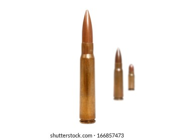 three bullets, two of them blurred deep in background