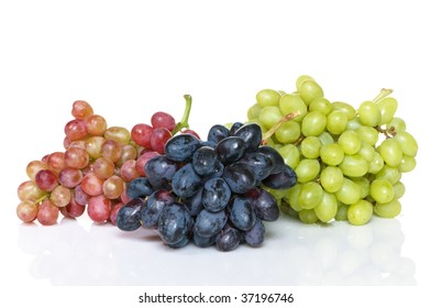 Three bunches of grapes in black, red, and green varieties