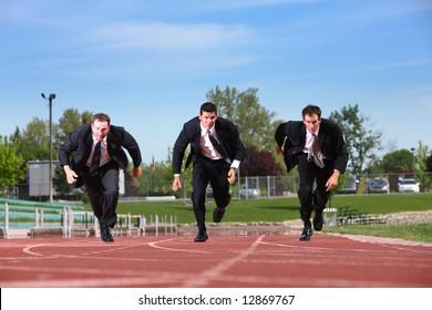Three business men running on track