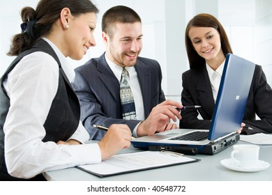 Three business people creating a business plan