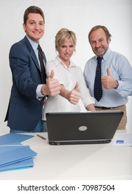 Three business people doing the ok sign