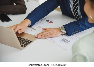 Three Business People Meeting working in office for discussing with a computer laptop and paper document sheet