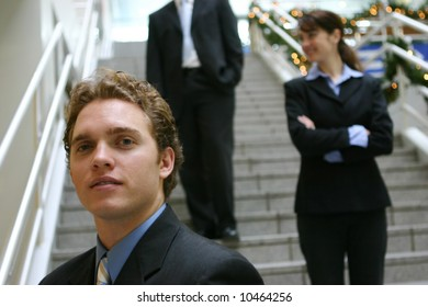 three business people standing on steps