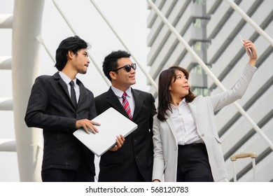 Three business people team making a Selfie outdoor.Business concept.