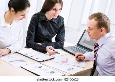 Three business people working together at office
