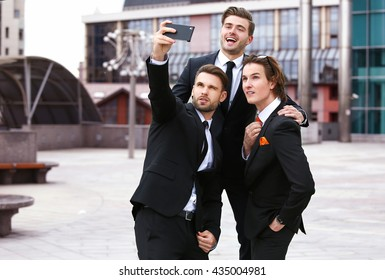 Three businessman doing selfie phone