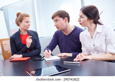 Three businessmen discussing something together