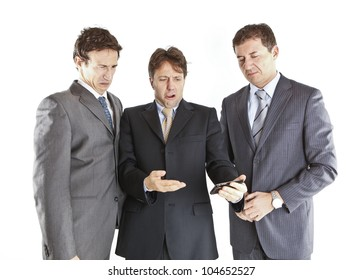 three businessmen looking at a smartphone