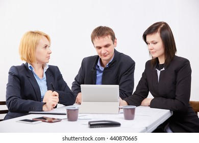 Three businessmen at a meeting